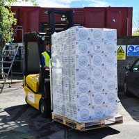 Forklift laden with boxes