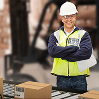 Warehouse pick and pack worker with boxes